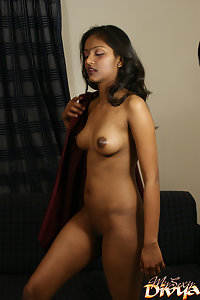 Hot divya unwrapping herself from brown sheet showing her boobs