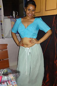 Horny Lily in blue blouse and petticoat stripping naked for fans
