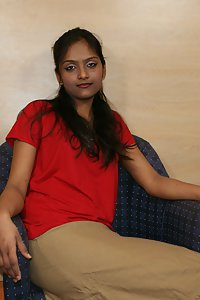 Divya in red top and brown skirt teasing her fan licking oranges