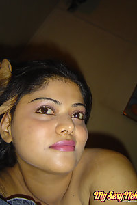 Indian Wife Neha showing off her big boobs in yellow camisole