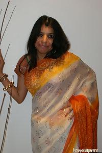 Kavya in banarsi sari doing a strip show for her fans