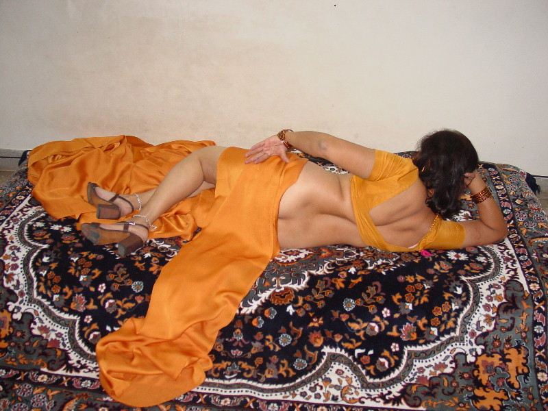 Opinion orange saree aunty nude