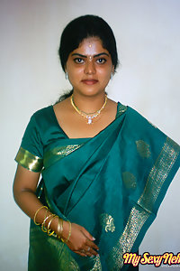 Indian Wife Neha in traditional green saree stripping naked