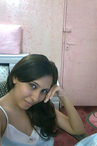 Hot Indian girl posing in bedroom