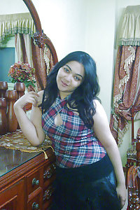 busty Indian girl in her bedroom posing